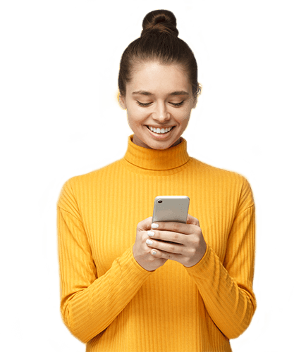 Woman holding phone in front of yellow wall
